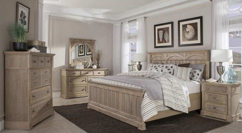 Elegant wooden bedroom set with striped covers and beach themed ornaments