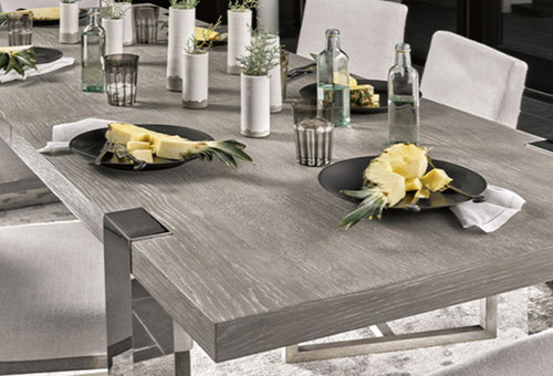 Dining room set with grey wooden table, stainless steel base